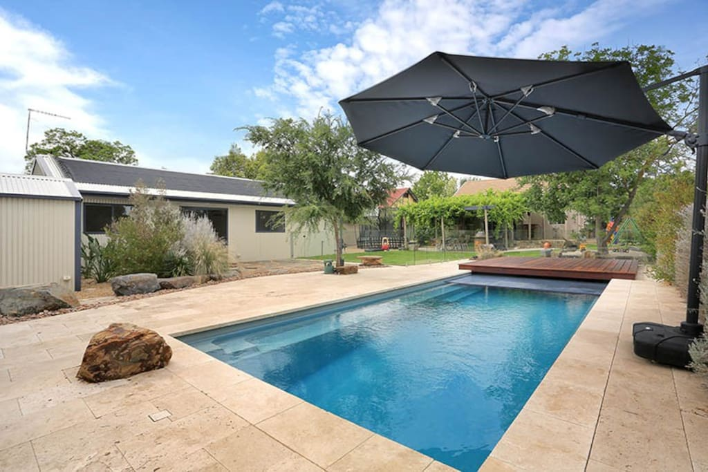 9x5 pool with deck and hard child safe cover.