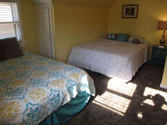 Second floor, bedroom 2, has two beds (Queen & Double)