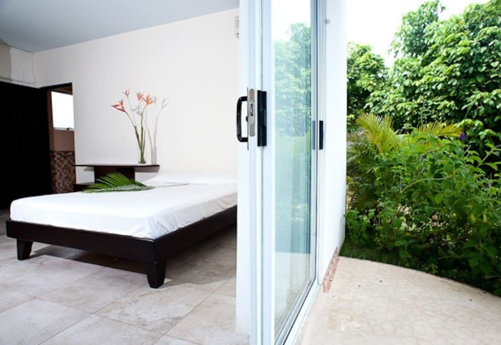 Downstairs bedroom, queen bed and twin bed, safe and private bathroom.