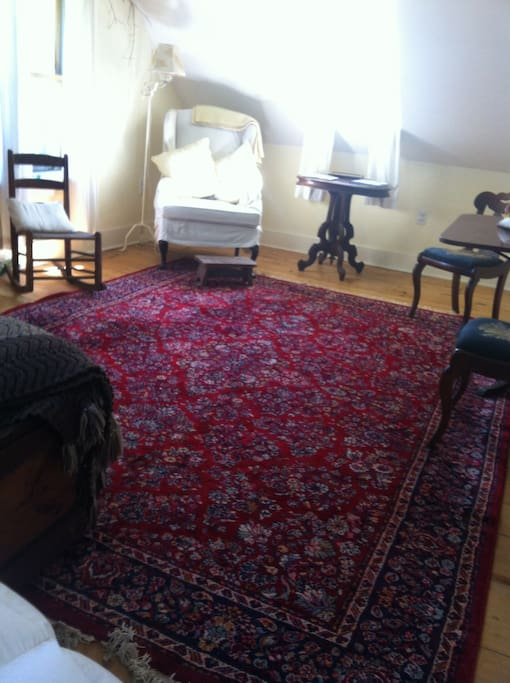 King Size King size Bedroom looking from bed onto Oriental rug with chairs, table on right hidden. Stretch; Do Yoga!