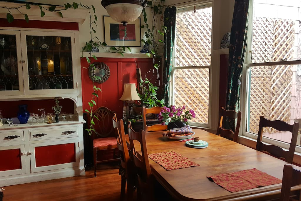 The red dining room and sitting room, available for your use whenever you like!