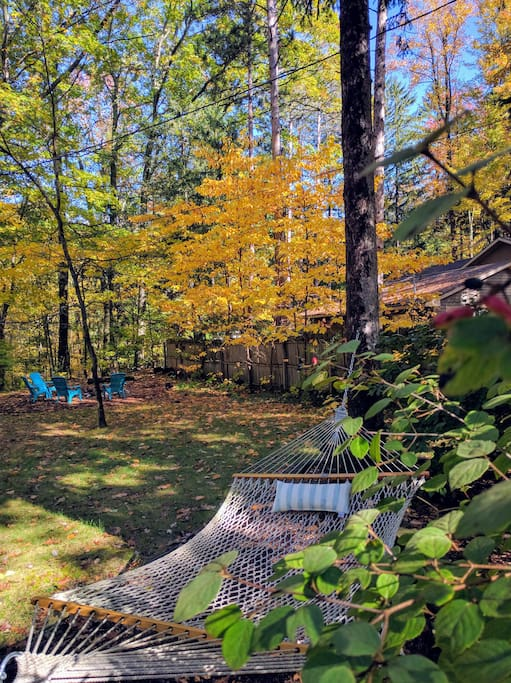 1.5 acres of property to enjoy, complete with a fire pit and a hammock.
