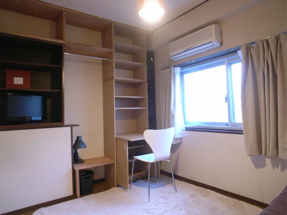 Room with desk, chair, AC, Flat TV, Window