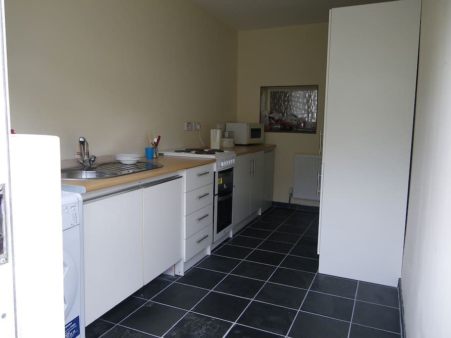 The kitchen with real slate floor