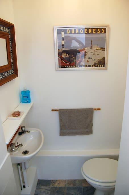 Toilet en suite to guest room.