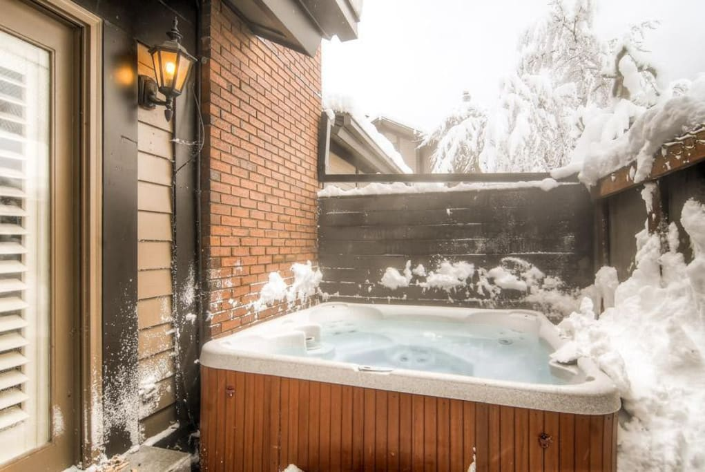 Outdoor private hot tub in winter! Lots of snow!