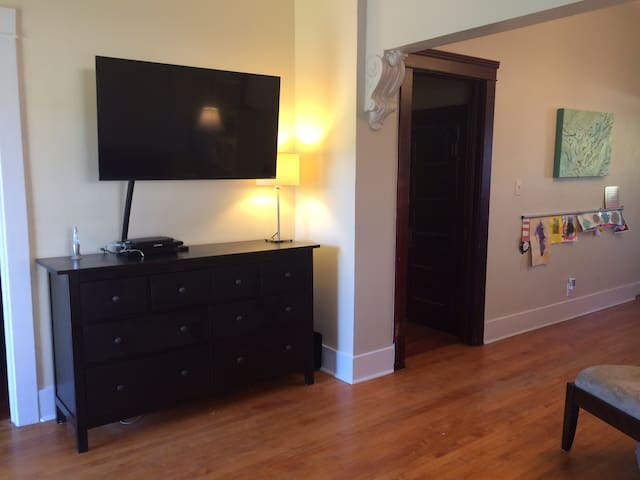 Living room features a large screen t.v.