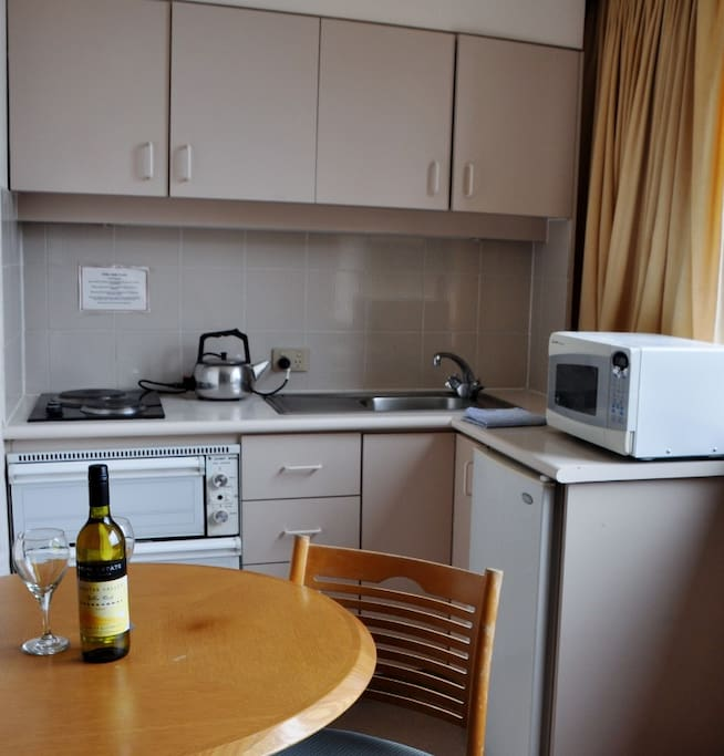 Fully equipped kitchen with all kitchen utensils including oven and griller