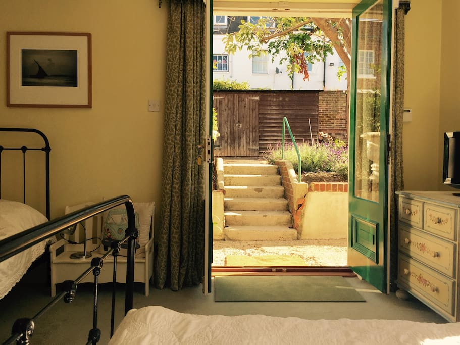 Steps leading down to Yellow Room through private patio doors