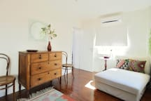 The bedroom has three large windows, so lots of light, as well as lots of space.