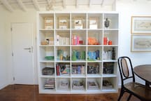 The bookcase has loads of books and DVDs for you to borrow, including guidebooks and dictionaries.