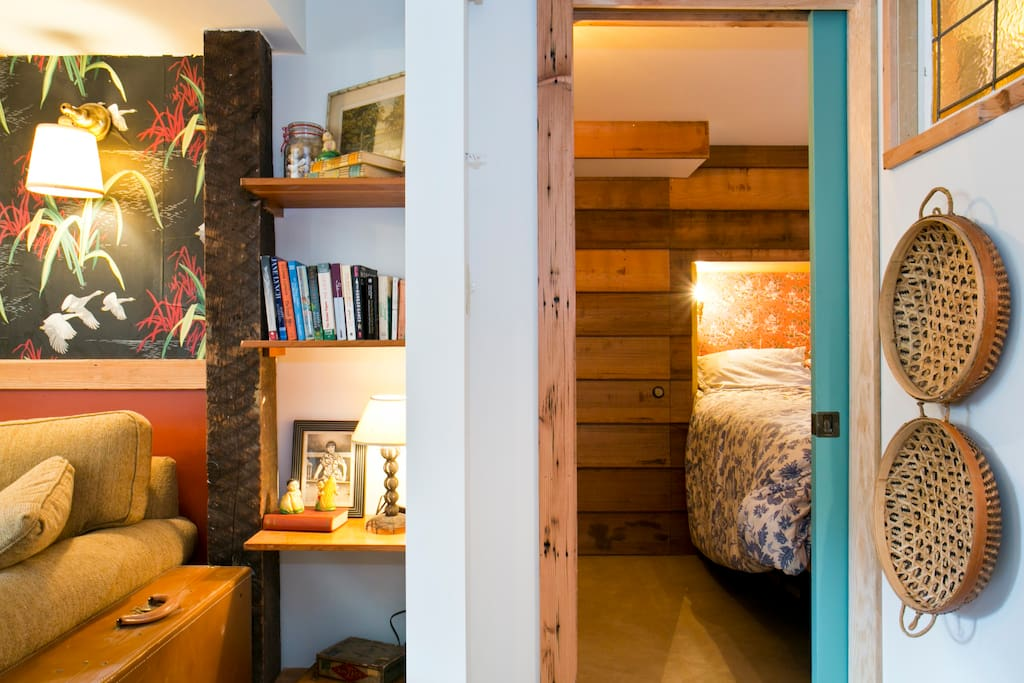 peek into the bedroom from living room (blue sliding door closes for privacy)