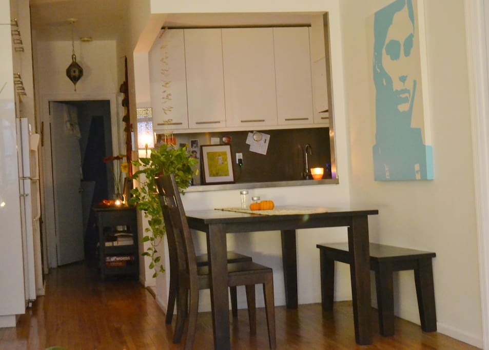 dining area with kitchen beyond it...