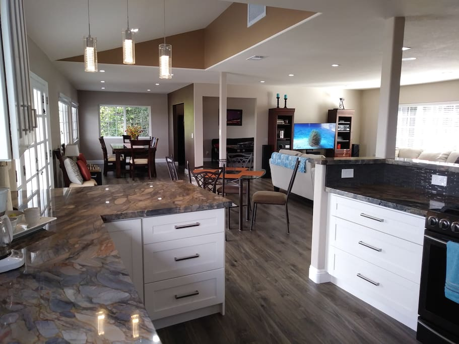 All New Kitchen with Quartzite Countertops and Black Stainless steel Appliances