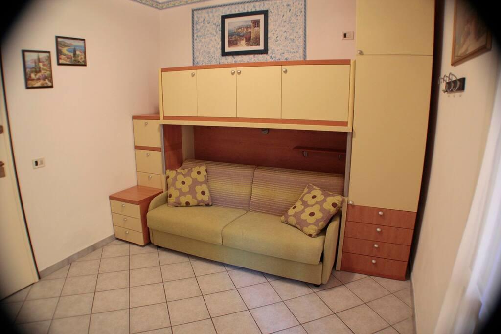 tinello con divano letto