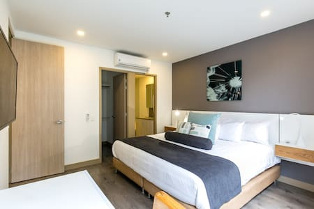 Enjoy our queen size bed, Flat screen TV and green surroundings.