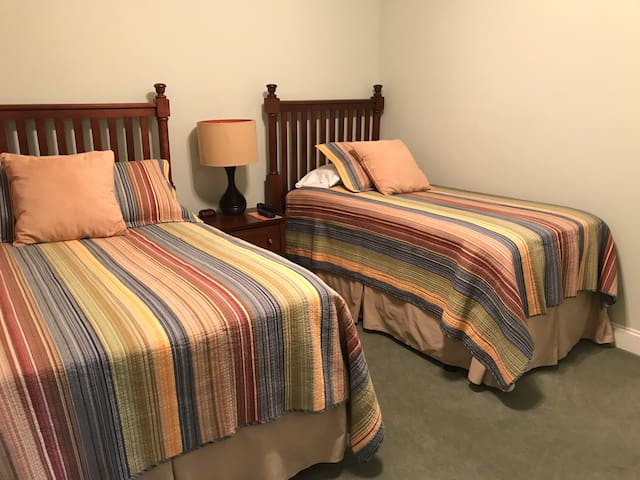 The guest bedroom has a full size and twin size bed both with a memory foam mattress topper for that extra level of comfort. Both bedrooms have a TV with cable.