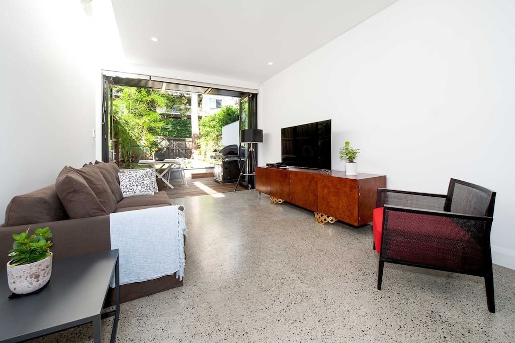 Comfortable family room with large screen TV and Foxtel