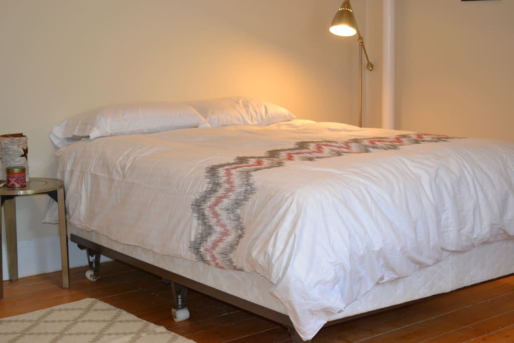 Queen Bed with fresh linens and duvet