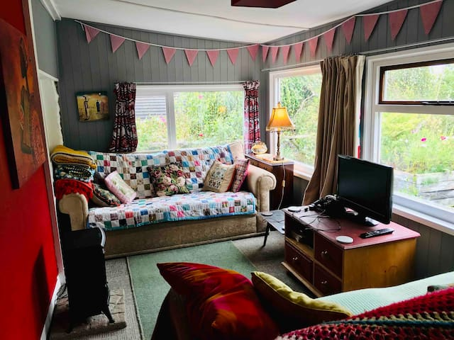 Comfortable lounge space with access to garden. DVD player, board games provided.