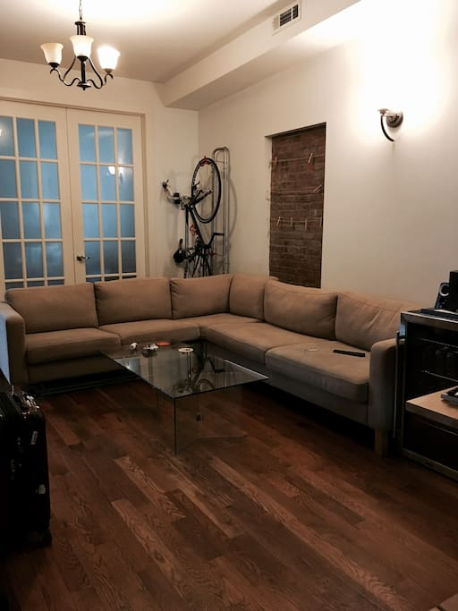 Large shared living room with high ceilings and cozy couch