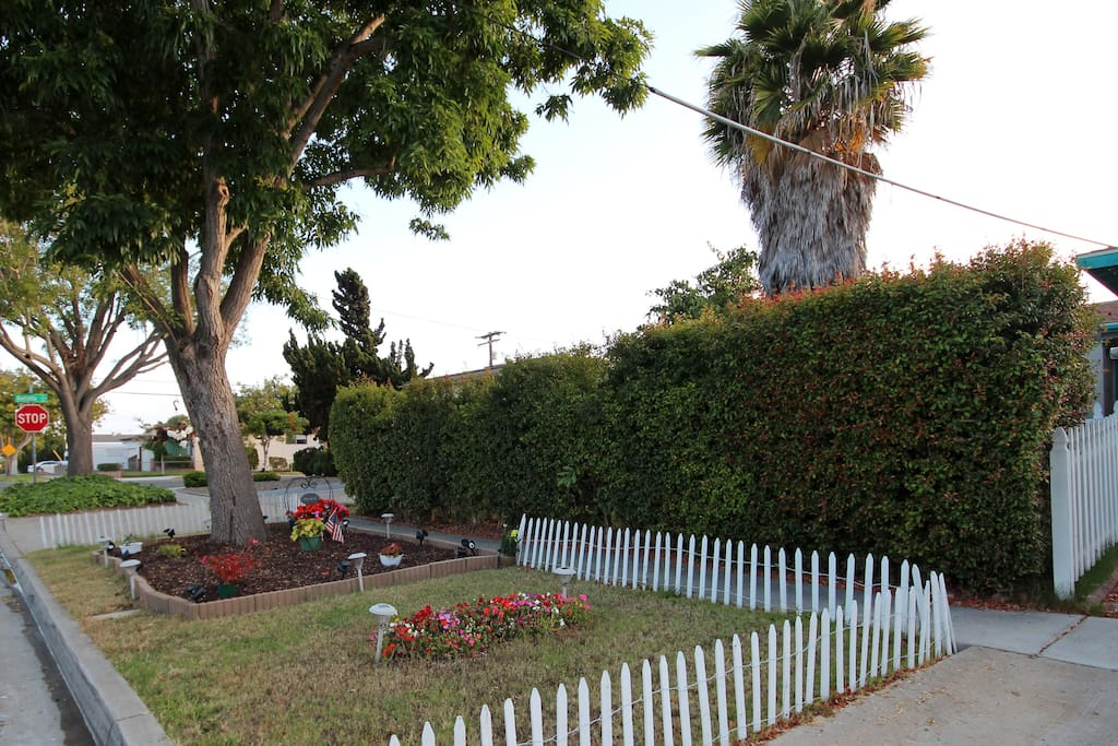 City property planting strip with miniature white picket fence