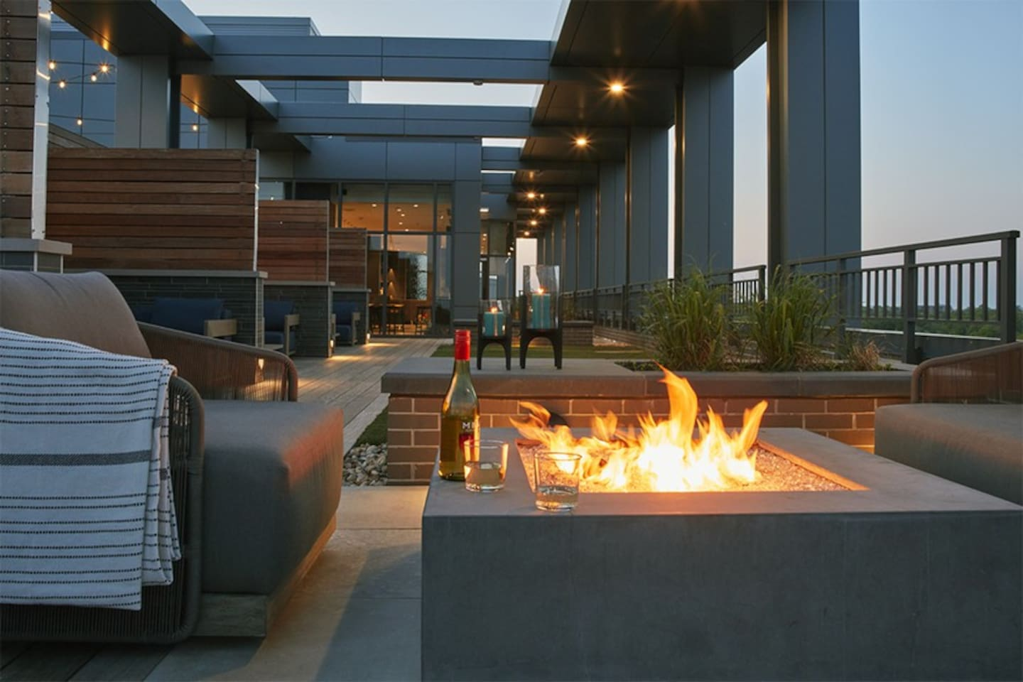 Firepit on the rooftop with a glass of white wine!