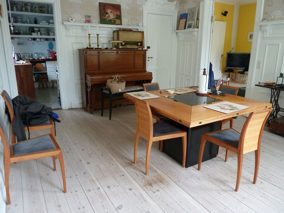 Dining room - with a piano and a guitar