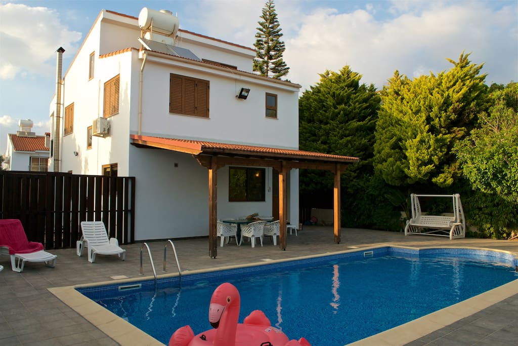 View of the back of the house, the private swimming pool and pergola