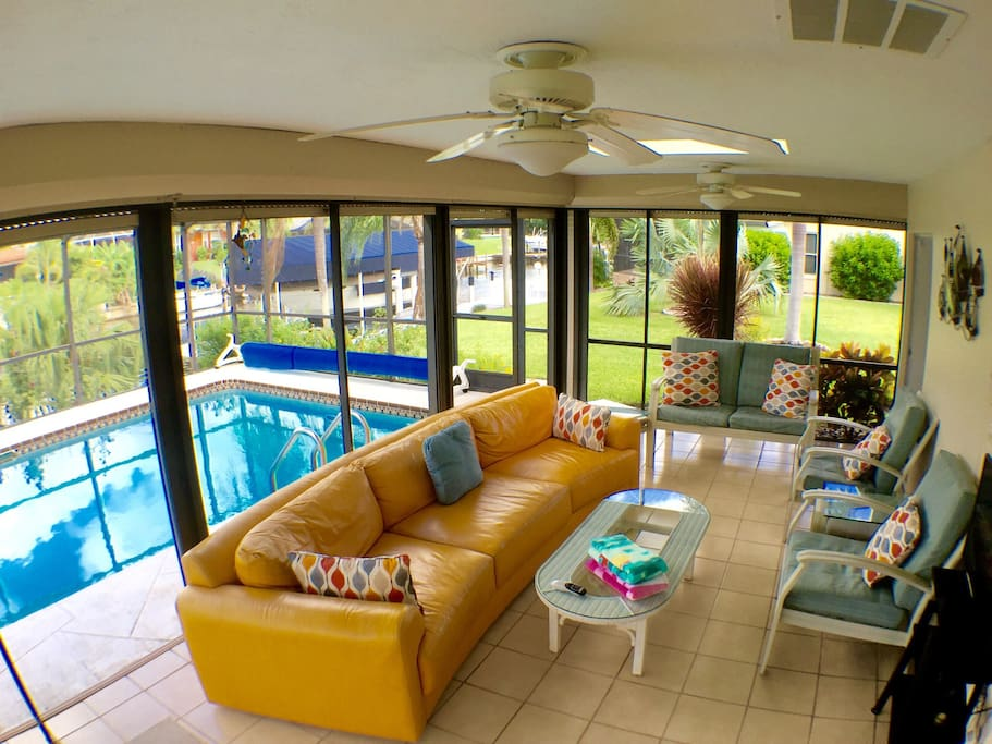 Spacious Lanai with plenty of seating. Also included: TV, BBQ, mini fridge and additional eating area.