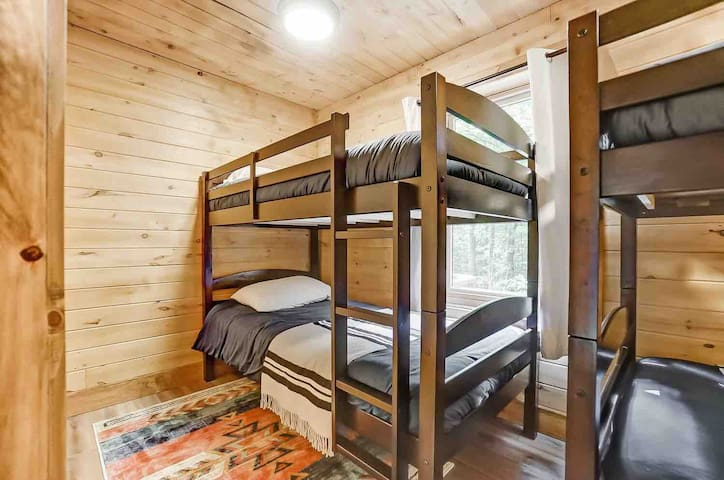 There are 2 sets of bunk beds in the basement bedroom (4 twin beds in total).  There are blackout curtains in this room also, hopefully encouraging your little ones to sleep (but we can't make any promises...).