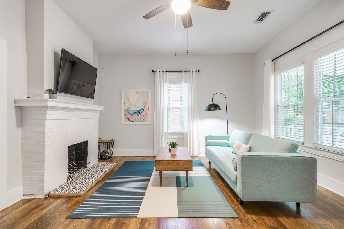 Bright Living Room with One Large Smart TV