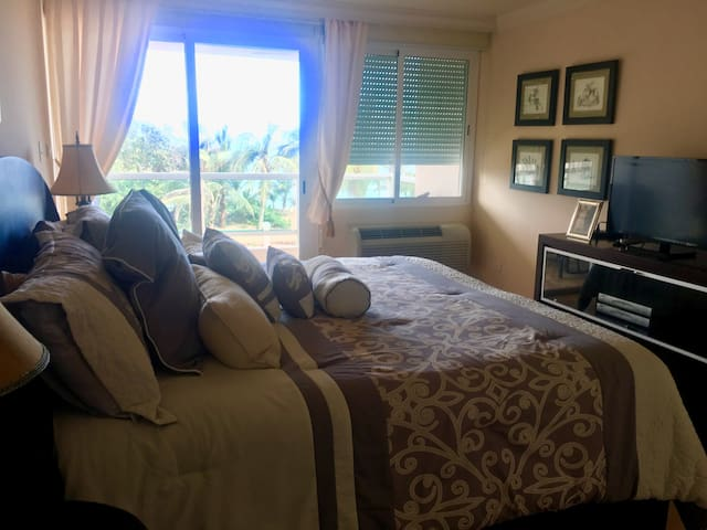 Master bedroom with king sized bed and balcony