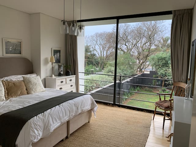 The 3rd bedroom also overlooks the garden. It has more feminine touches.