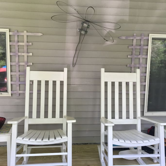 "Large screened front porch with rockers, table/chairs -- perfect to sit out here with glasses of iced tea or ""adult beverages"""