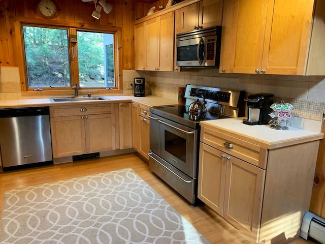 Double oven and 5 burner range, microwave, Keurig and 12 cup coffee makers