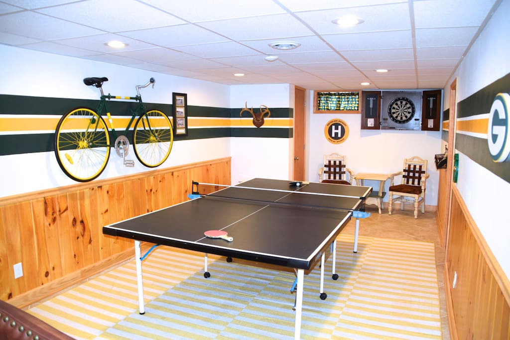 Packerland basement with ping pong and darts.