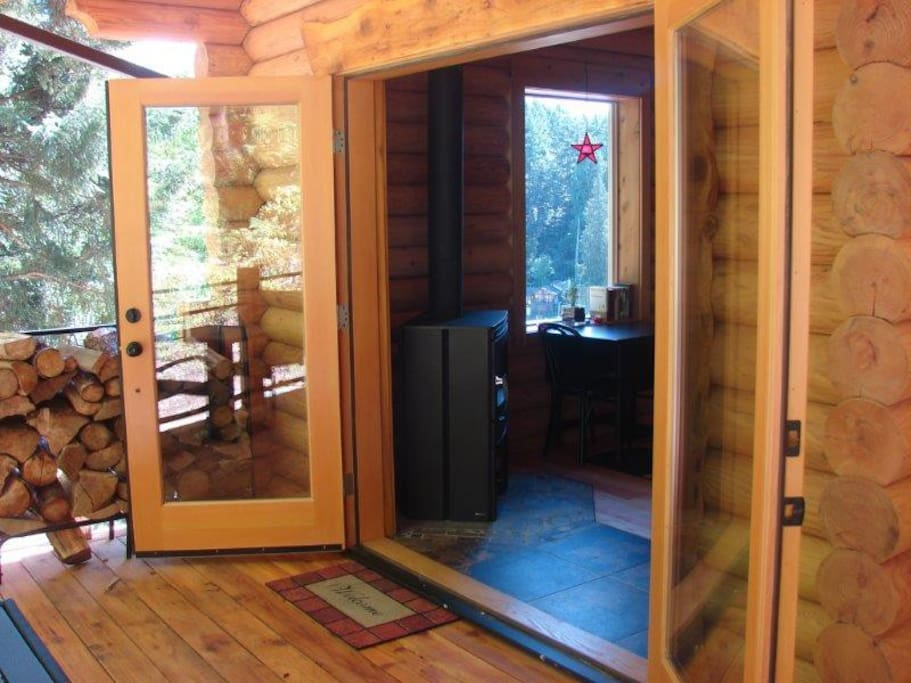 Large wooden french doors leading onto deck