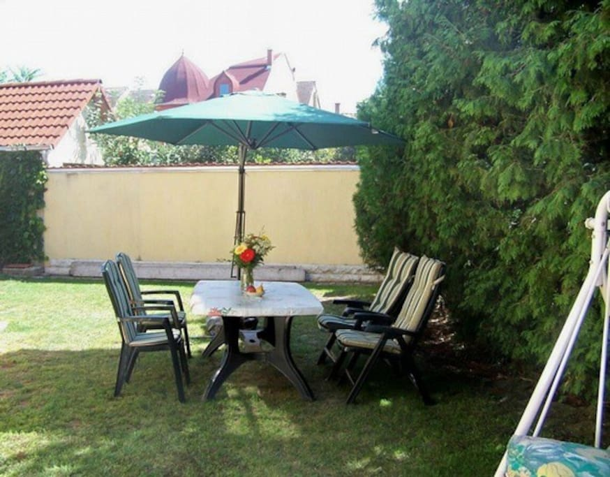 The pleasant inside garden with table and chairs for our guests.