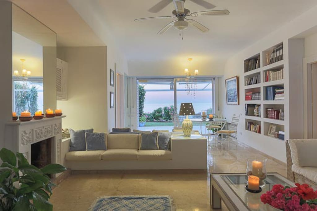 LARGE OPEN PLAN LIVING & DINING AREA WITH GARDEN & OCEAN VIEWS