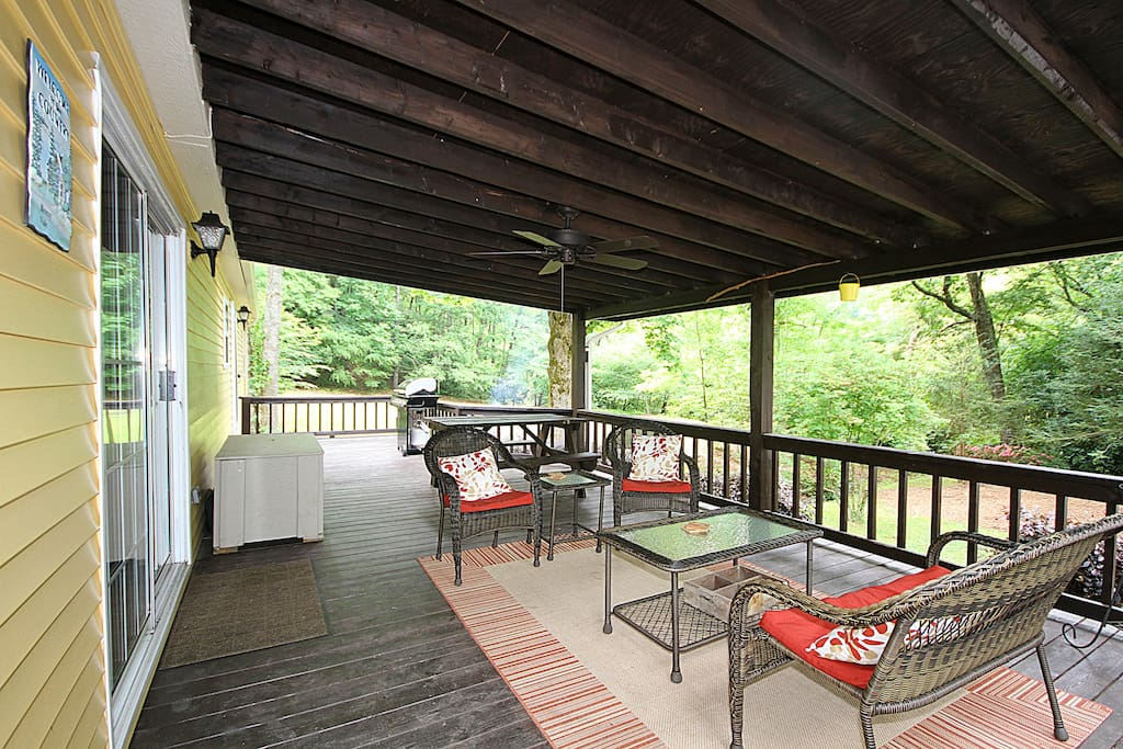 Covered back deck with picnic table, seating for 4 and a gas grill