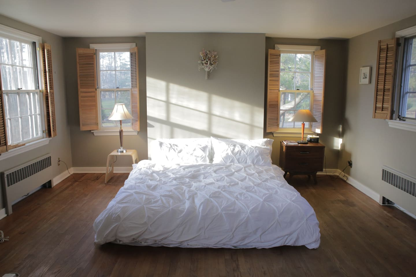 This bedroom is quite large with windows facing north, south, east and west