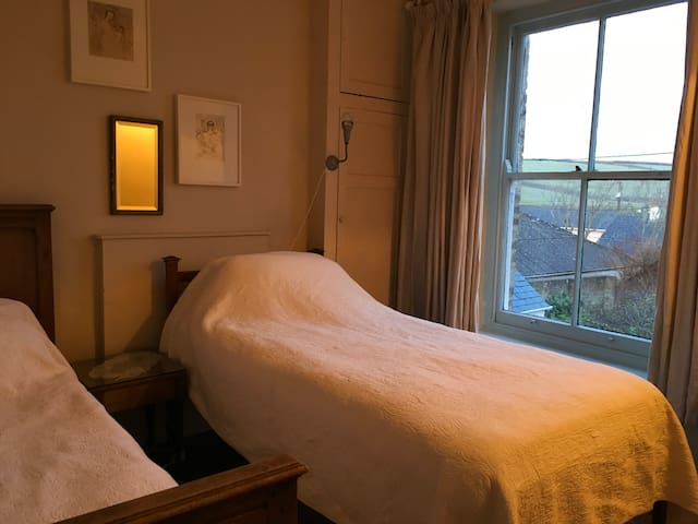 Twin bedroom overlooking the garden