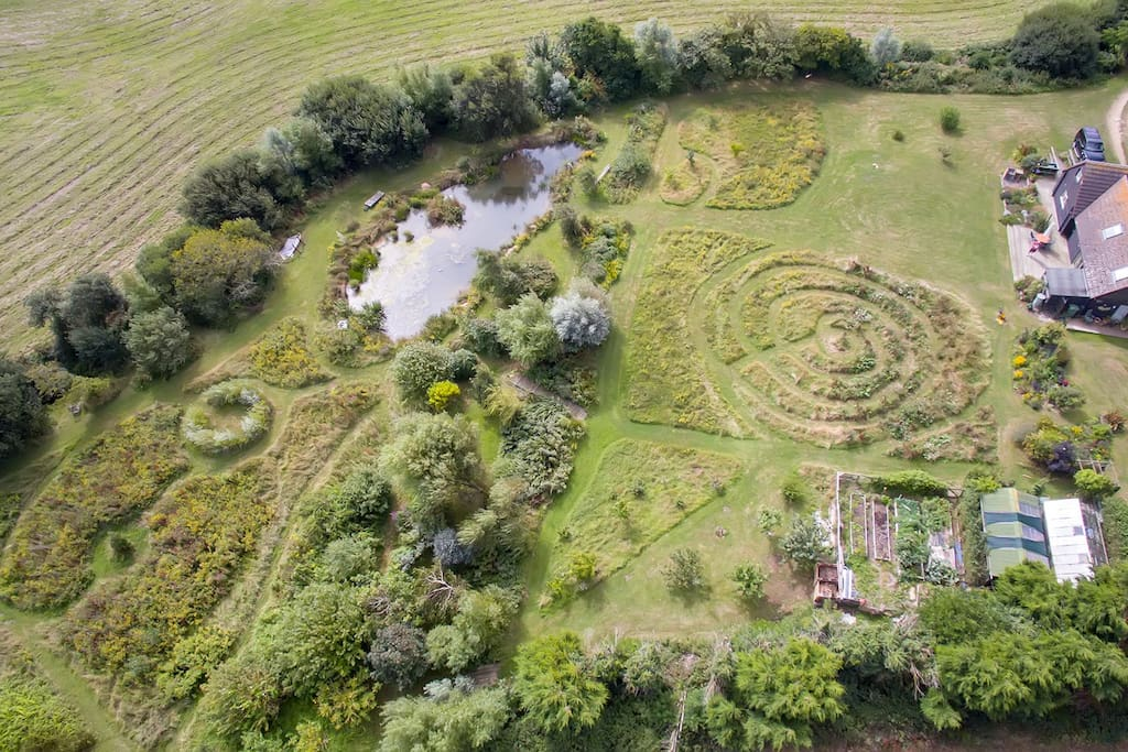 Aerial shot of The Little Barn showing wildflower area, lake and wetland