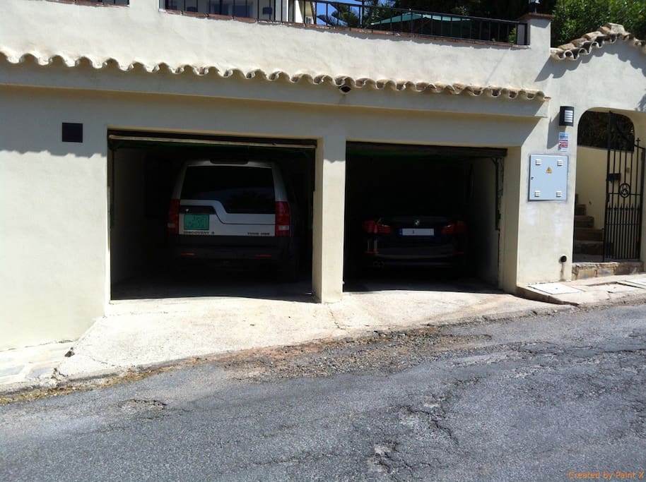 Garage and entrance to the right