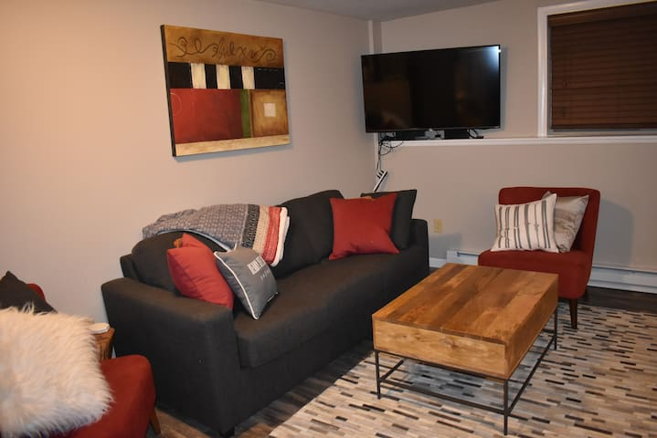 """Living room with new furniture and 50"""" 4K Smart TV"""