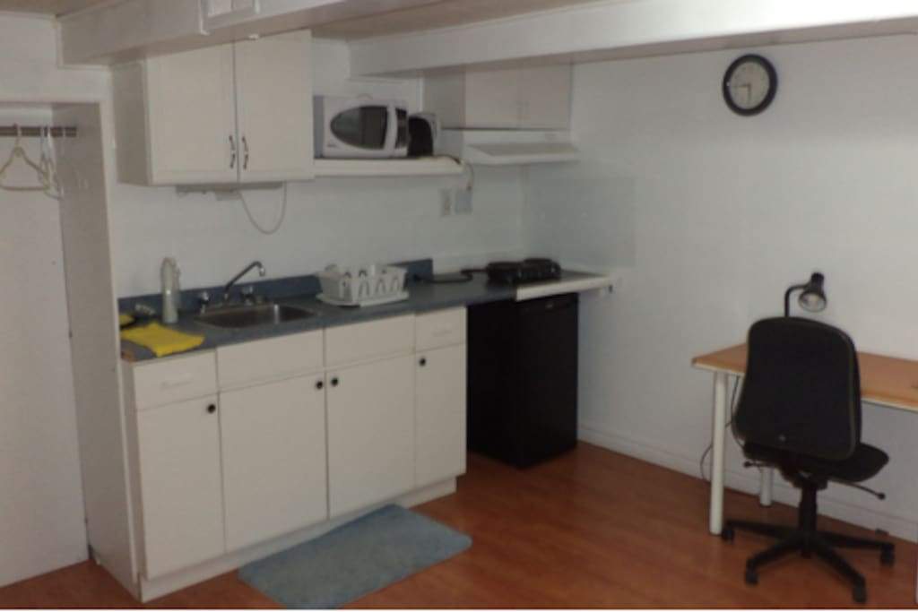 Private kitchen furnished with cooking wares, plates, forks, microwave, fridge, bread toaster, water kettle,etc