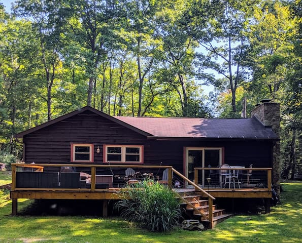 Enjoy your morning coffee on this spacious back deck while enjoying the sounds of nature and the running stream down in the woods