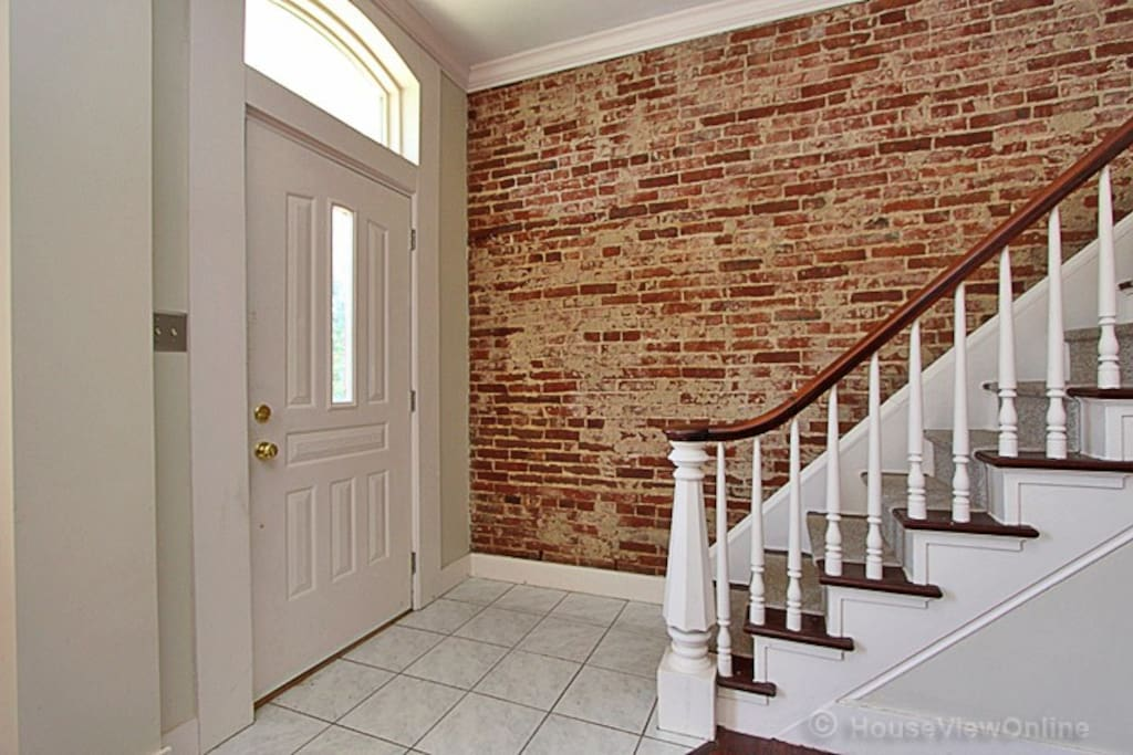 exposed brick on way to upstairs bedroom