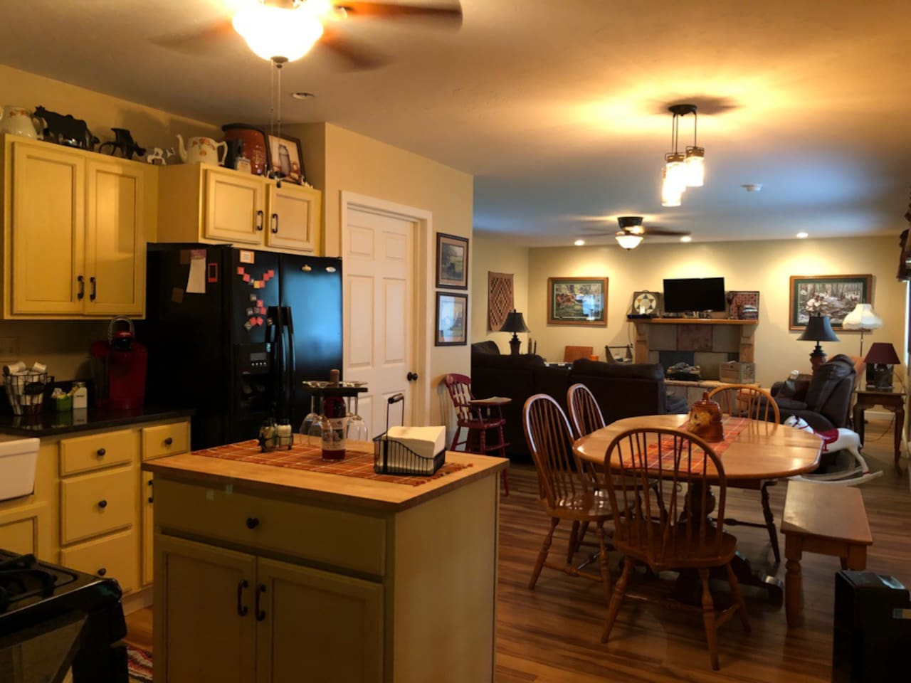 Beyond the kitchen and dining area is a cozy living room.